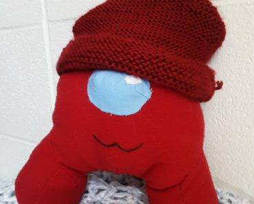 I didn't want to pay for an official Bean plush, so I made my own + a cozy beanie. They have a zippered pouch in the back to hold a mini crewmate, candy, or other goodies.